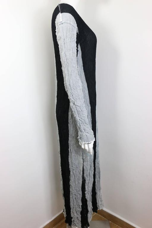 - Vintage Issey Miyake black and grey striped pleated long dress.   - There is no size tag and name tag but it is around size Japan M.   - Height: 52in, Bust: 32in, Waist, 26in (measurements are approximate).