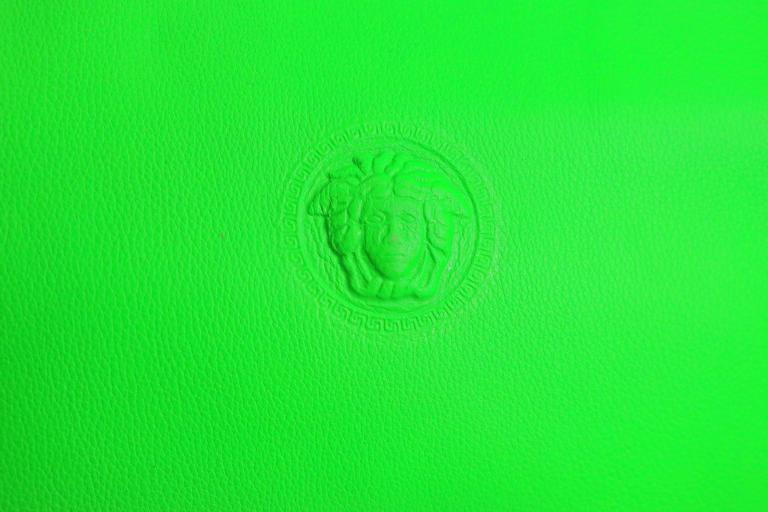 - Vintage 90s Gianni Versace Couture neon green leather bag with iconic Medusa logo.   - Made in Italy.   - Length: 11in, Height: 9.5, Handle height: 4in, Width: 3.5in (measurements are approximate).   - Condition: Never been used before but some
