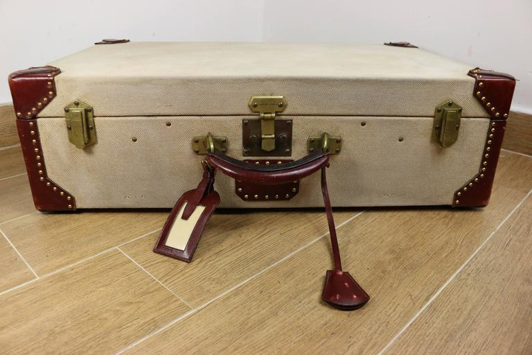 "- Vintage 70s Hermes canvas rigid trunk, reinforced corners with red leather, gilt brass hardware. Comes with keyfob, keys, luggage tag and printed ""MEM"" on the top handle. 
