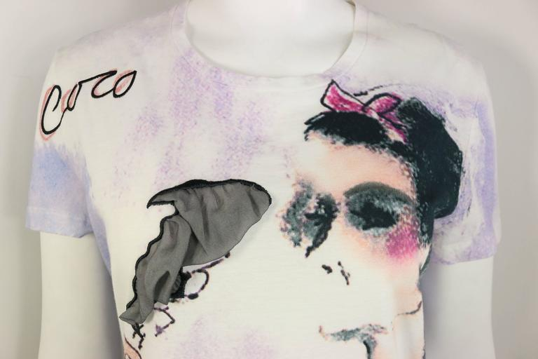 - This chic and rare Chanel t-shirt with Coco Chanel smoking print is a good collectable item. The smoke is in grey silk fabric.  Also, the t-shirt has some dye print (purple, blue and white) effect all over. Looking chic with jeans and jacket!