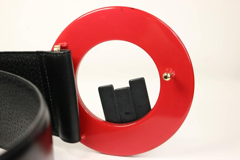 - Vintage 80s Charles Jourdan red plastic statement buckle black leather belt. Featuring three black vertical statement sticks on the buckle.   - Made in France  - Length: 24- 26 inches