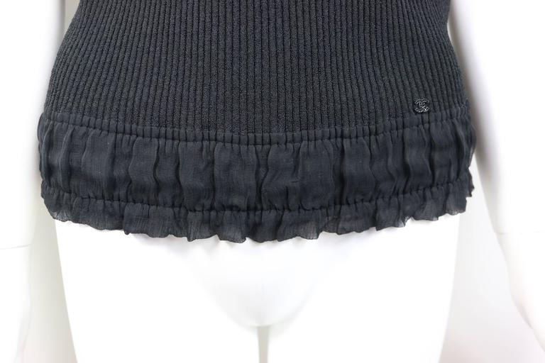 d953f6e83af9e This beautiful Chanel black ribbed knit tank top has silk ribbon bow  spaghetti straps