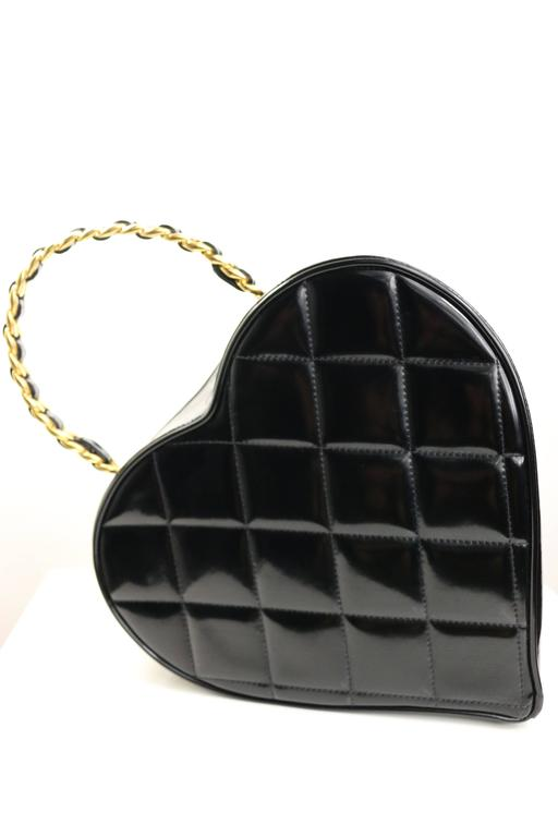 - Vintage Chanel black patent quilted leather heart-shaped vanity chain handbag from 1995 collection. 