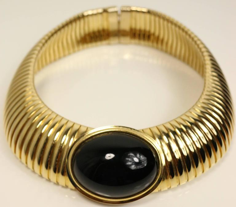 - Vintage 80s black stone serpent link structured choker in gold-toned brass. 80s is back this fall and Fall 2016 Saint Laurent collection has a similar choker!!! 