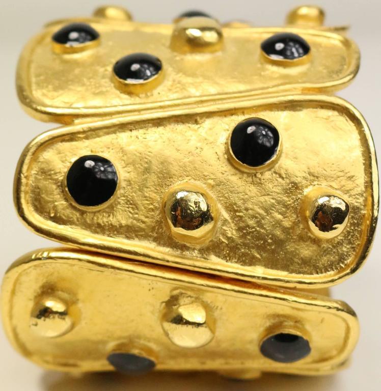 - Vintage 80s black and gold metal wild cuff bracelet.   - Length: 7cm. Width: 6cm.
