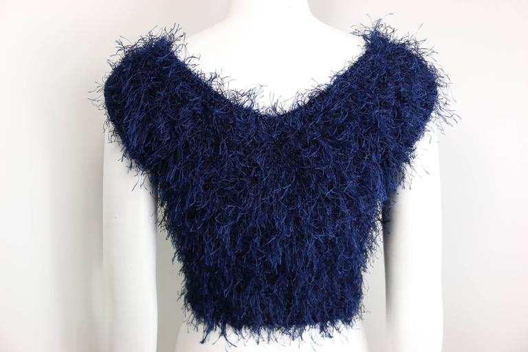 - Vintage 90s Christian Dior blue feather scoop neck cropped top.  