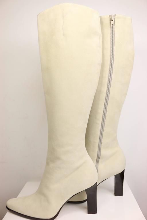 - Celine white suede long boots.   - Fully lined with a wooden heels.   - Size 38.   - Made in Italy.  - Height: 20 inches.