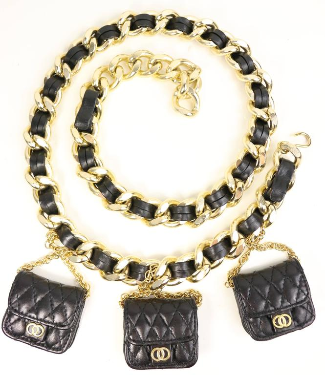 - Vintage 80s black leather gold chain link belt attached with three drop black mini quilted leather gold chain flap handbag.   - Length: 39 inches. (you can hook wherever you want.)