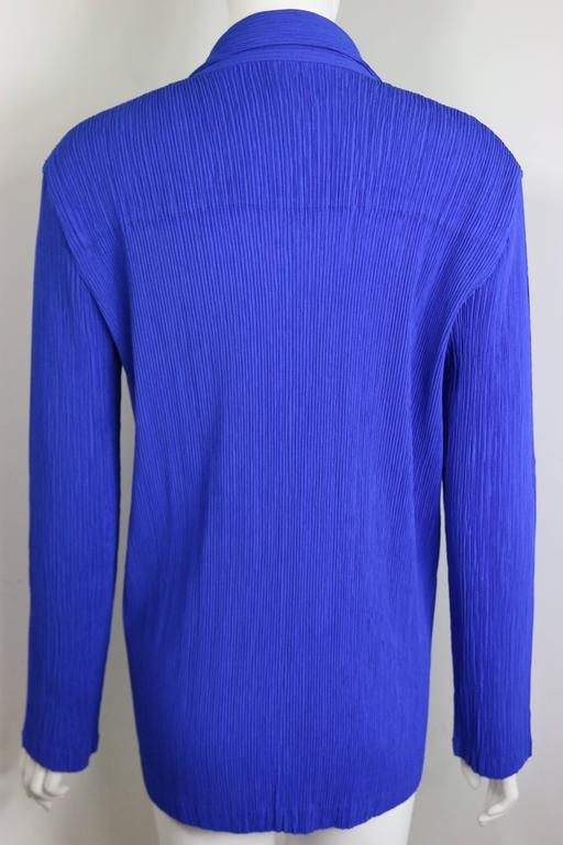 - Issey Miyake blue pleated jacket. Signature pleated with striking colour blue.   - Featuring three buttons closing.   - Made in Japan.   - Size M.   - 100% Polyaster.