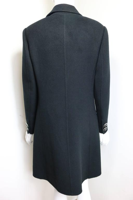 - Vintage 90s Gianni Versace Couture black (rabbit and goat) wool long coat. This is a classic straight cut and collectable item for winter.   - Featuring six front black leather silver medusa buttons. Two black leather silver medusa buttons on