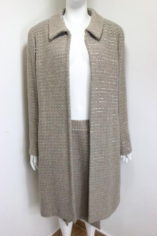 - Vintage Chanel grey/camel tweed coat and skirt ensemble with gold and silver sequins from Fall 2000 collection. The skirt has a pleated silk lace underneath. The whole outfit has a shiny effect because of the sequins.   - Featuring a hook