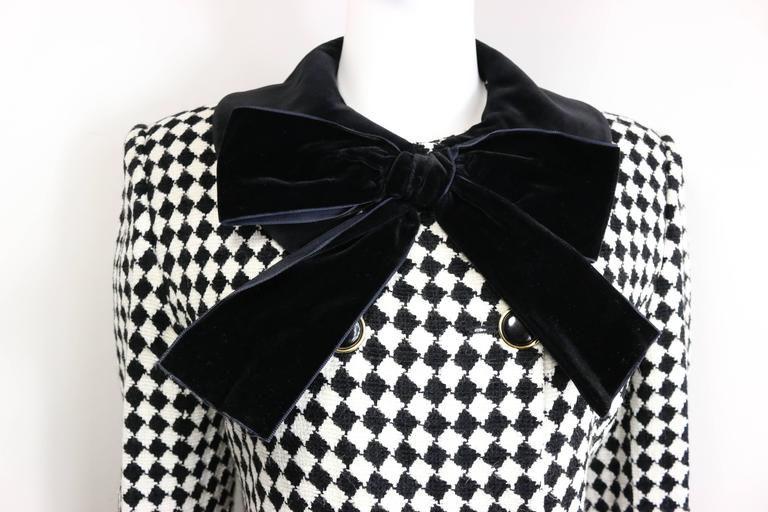 - Vintage 90s Angelo Tarlazzi double breasted black and white harlequin check coat attached with a black velvet bow collar. This 70s looking coat is very retro looking and fun to wear! 