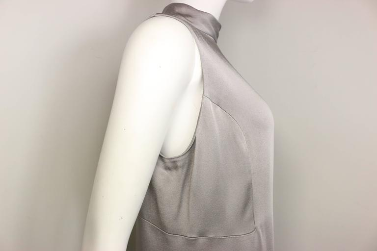 - Vintage 90s Donna Karan classic silver satin high neck sleeveless shift dress. This dress is more A-line. It is good for an evening night out.    - Made in Hong Kong.   - 52% Acetate, 48% Rayon.   - Size US 8, IT 42, FR 40.