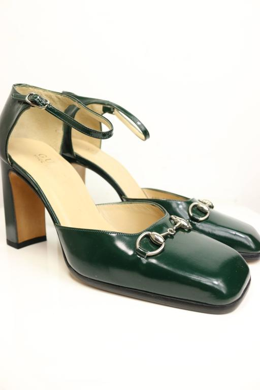 - Vintage Gucci by Tom Ford classic green leather square toe pumps with strap from fall 1996 collection. After 20 years, it stills look trendy and chic!    - Featuring Gucci classic and signature silver buckle. Rectangle high heels.   - Made in