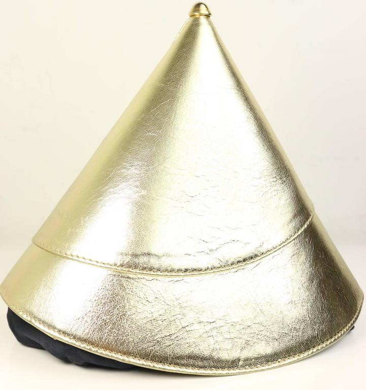- Vintage 80s Escada gold metallic leather in Triangle and round party hat shape handbag. Featuring black satin drawstring closing and white/gold stripe lining with zipper interior. A gold metal hardware on the tip top. This is a very unique, chic