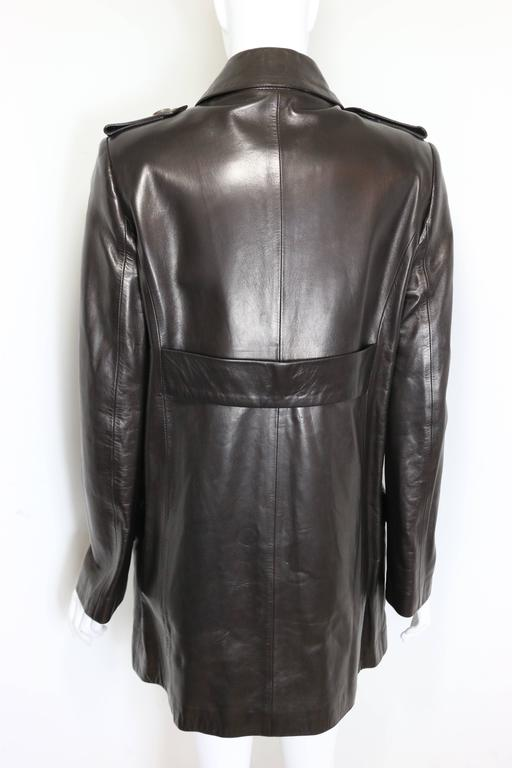 - Gucci by Tom Ford brown leather double breasted Jacket from Fall 1996 collection. The details and the fine leather of the coat are long lasting!   - Featuring twelve buttons fastening. Four flap pockets, Epaulette style with button details and a