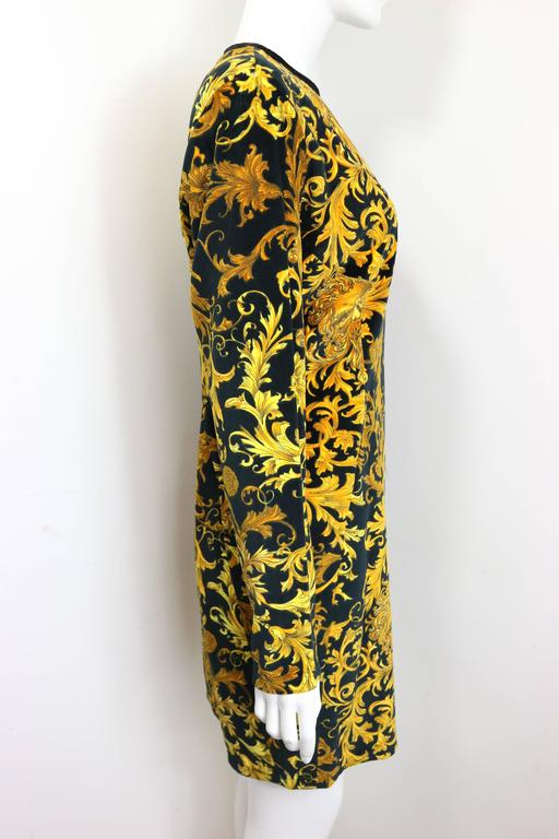 - Vintage 90s Gianni Versace jeans couture gold medusa velour dress. This dress is one piece and featuring back zipper closing. Signature and iconic Versace medusa printed dress is one of a kind! The condition is mint and truly collectiable for