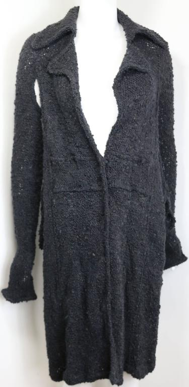 - Vintage 90s Costume National grey cashmere long knitted cardigan with both sides split cut.  You can wear something underneath and treat it like a dress as well. Stylish and still very modern knitted cardigan to wear now!  - Featuring five