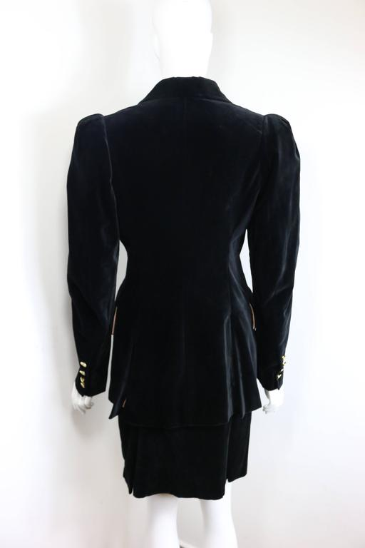 - Vintage 90s Vivienne Westwood black velvet double breasted and skirt ensembles. The statement victorian style broad shoulder padded is so Vivienne Westwood. Her style is always very different, bold and rock and roll!!! 