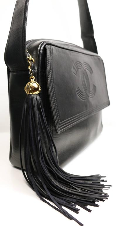 23f763829dd3 Chanel Black Leather Flap Bag with Tassel In Excellent Condition For Sale  In Sheung Wan,