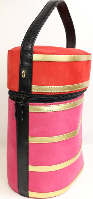 - Vintage 80s Charles Jourdan red and pink suede gold leather stripes round shaped handbag with detachable black leather strap. Lovely bold colours suede is one of a kind!!!  - Made in France.   - Length: 6 inches. Height: 8 inches. Strap