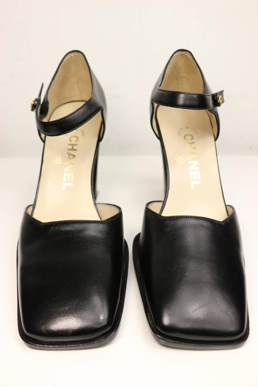 59bba2cc06f2 Vintage 90s Chanel classic black leather square toe heels. Featuring gold   quot CC quot