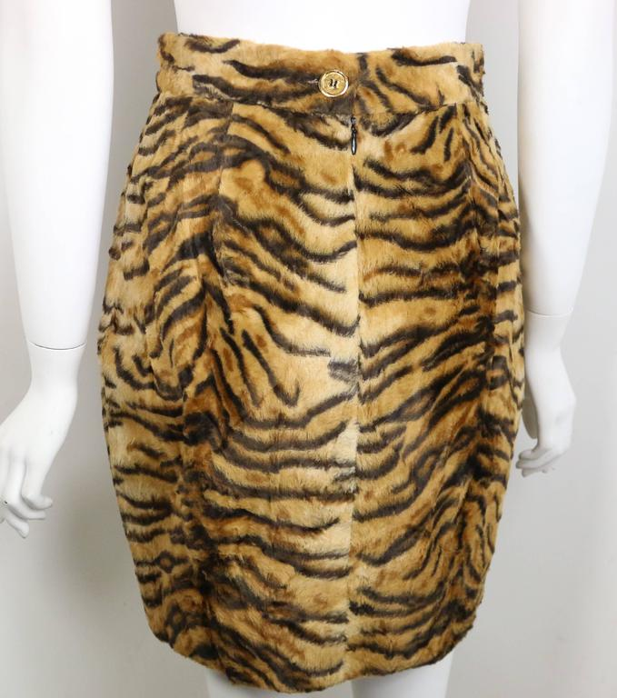 - Vintage 90s Gemma Kahng leopard faux fur skirt.  Zipper closing and a gold button fastening at the back.  Animal print will never go out of style!