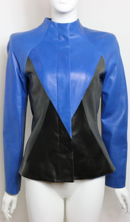 - Vintage 90s Givenchy by Alexander McQueen  blue/black/grey colour blocked geometric shoulder padded leather jacket. This is one of a kind leather jacket!  - Five hidden front panel buttons in blue.     - Two side pockets.   - Made in France.  -