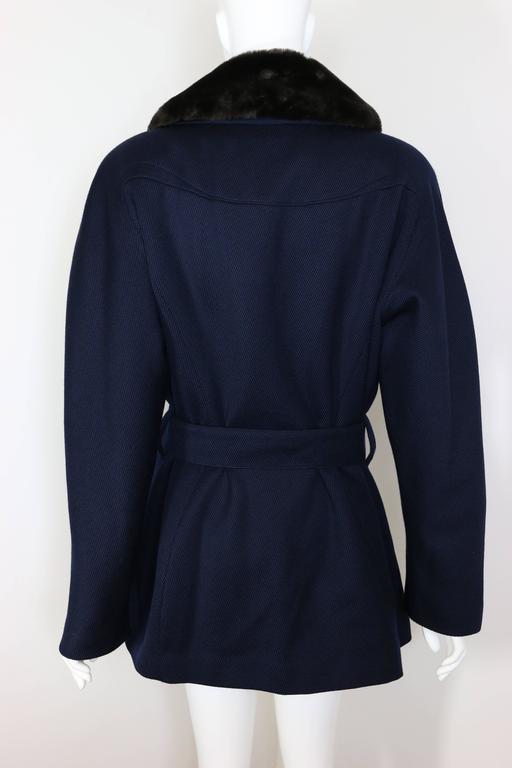 - Vintage 90s Thierry Mugler Navy Blue Faux Fur Detachable Collar Double Breasted Belted Coat. Never been worn with original tag!   - Round shoulders.    - Featuring ten silver buttons.   - Silver belt buckle.    - Four front pockets.    -