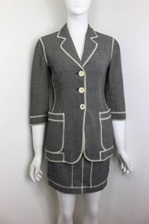 - Vintage 90s Moschino Couture in black and white check pattern with white stitches piping jacket and skirt ensemble. The jacket is three quarter sleeves. The word