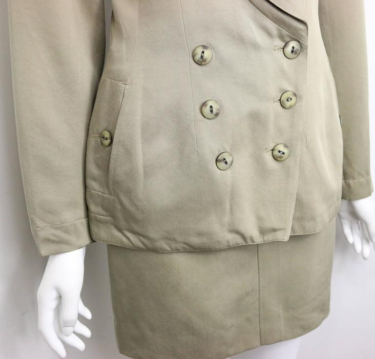 - Vintage 90s Alaia Khaki double breasted jacket and skirt ensemble. Featuring six front buttons closure, two side pockets with one button closure on each. Skirt has two front pockets with button closure and one back pocket button closure.   - Made