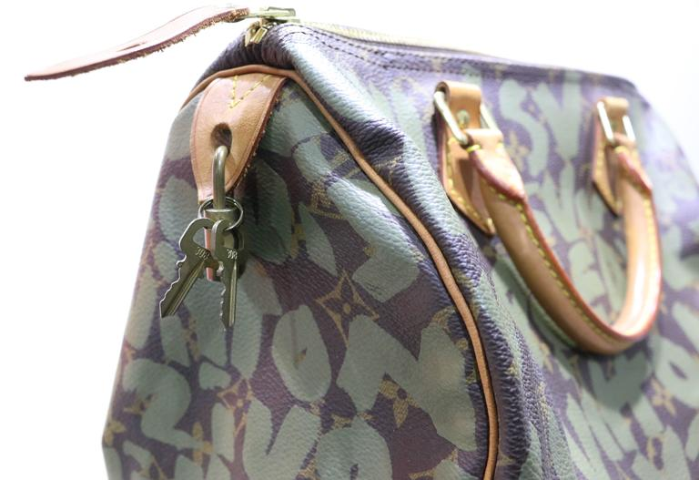 bc0ed7026f63 This rare and limited edition Louis Vuitton monogram canvas 30cm Speedy by Stephen  Sprouse covered