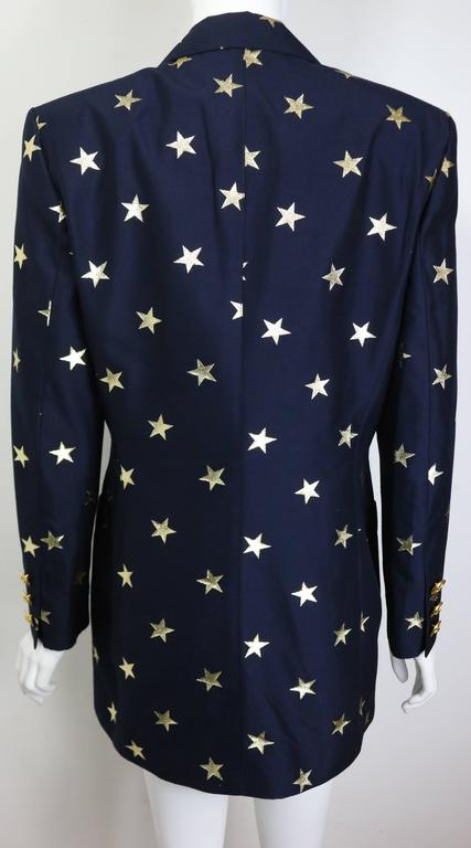 "- Vintage 80s Escada navy with gold stars pattern double breasted blazer. This one of a kind blazer represent the glamours , big silhouette and the golden era of the stylish 80s!!!  - Featuring six front gold toned ""Star"" hardware buttons closure."