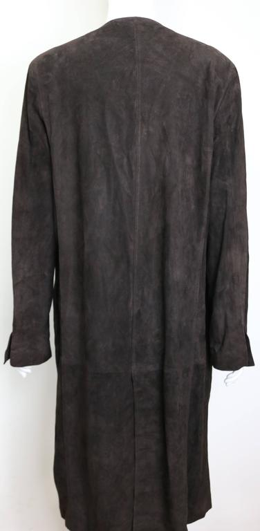 - Vintage 90s Gucci by Tom Ford brown suede long coat without button closure. Featuring a open split cuff and back vent. This long suede coat is made in very fine light suede leather which gives you a sense of luxury and chic. Tom Ford is the master