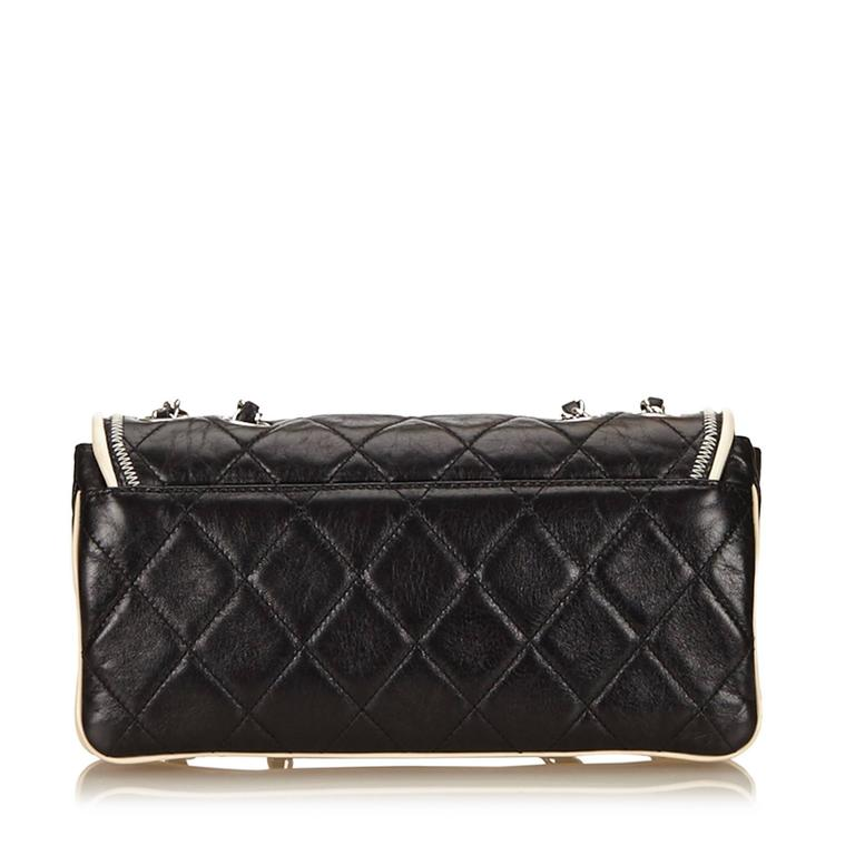 - This Chanel black with white trim piping east west flap bag features a quilted leather body with zipper details, silver-tone shoulder chains, a front flap with a twist lock closure, and an interior zip pocket.  - Made in France.   - Size 27cm x