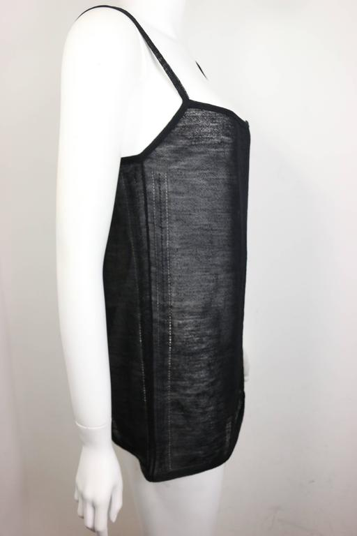 - Gucci by Tom Ford black wool see through spaghetti tank top from 1997 spring collection. One of the famous Tom Ford Gucci collection in history!   - Made in Italy.   - Size L.   - 85% Wool, 15% Nylon.   - Orignal tag still on.