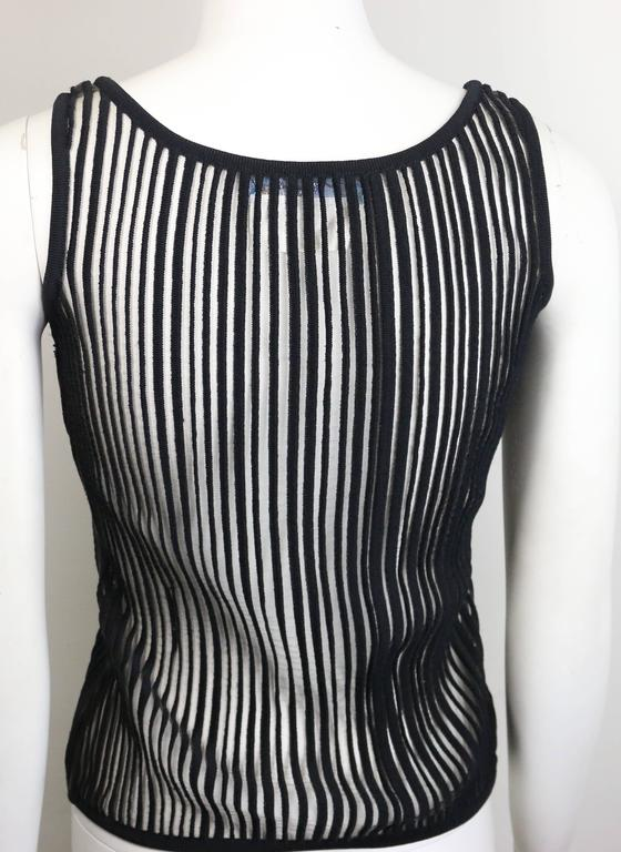 - Vintage 90s Thierry Mugler black knitted vertical stripe see through tank top. This sexy tank top is rare!   - Made in Italy.   - Size M.   - 90% Nylon, 7% Polyamide, 3% Elasthanne.