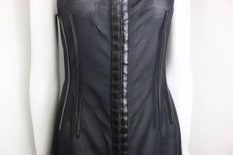 - Vintage 90s Plein Sud black leather trim see through sleeveless dress. Featuring thirty hooks for fastening closure.   - Made in France.   - Size 42.   - 77% Nylon, 23% Spandex.   - Original tag still attached to the dress.