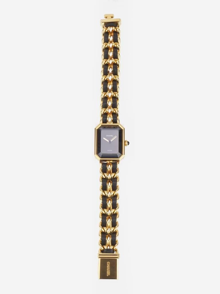 - Vintage 90s Chanel black leather gold plated watch in Size L. This premiere watch is one of the classic style of Chanel.   - Made in Switzerland.   - Size: Face Dimensions: 2 x 2.5 cm. Length: 16.8 cm.   - Include: Booklet.   - Product Code: