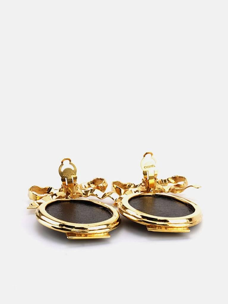Women's Chanel Gold Plate Bow with Dangle White Statue Clip On Earrings For Sale