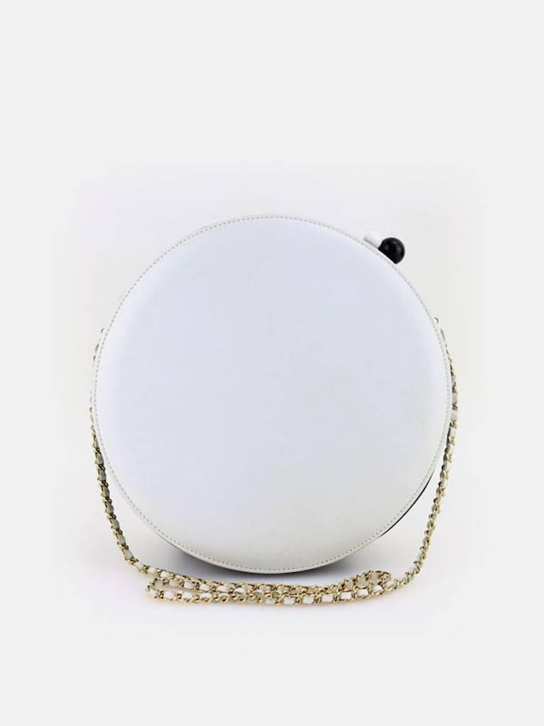 - Chanel black and white lambskin leather round shaped shoulder bag with white leather gold chain strap circa year 2003 -2004. Featuring a white leather interior and one interior pocket. Seems that this bag symbols the circle of life and its fun to