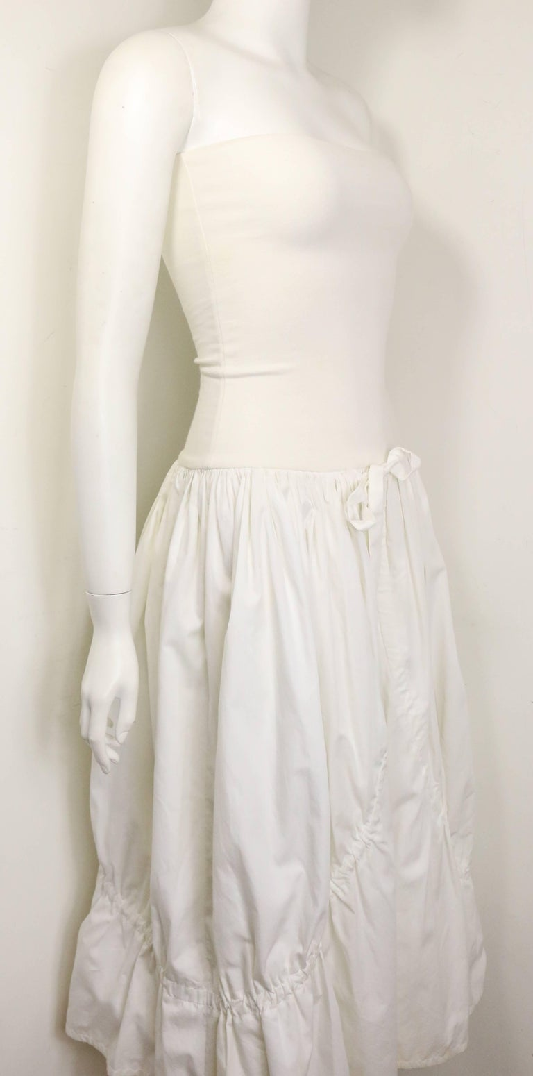 - Vintage 90s Dolce and Gabbana white cotton strapless dress. Featuring two layers seaming with drawstrings. There are two drawstrings fastening on the outside layer and two drawstrings fastening on the inside. Its a very interesting dress with