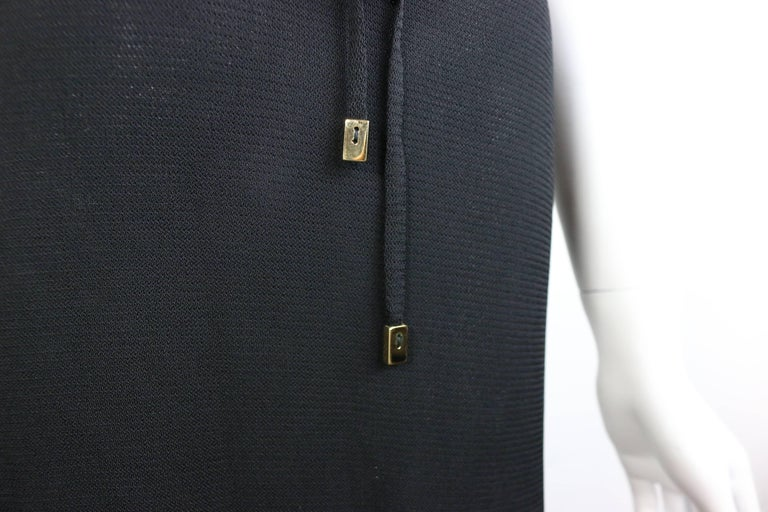 - Vintage 90s Gucci by Tom Ford black dress. Featuring a double layer with v-neckline. It comes with a same fabric belt with two gold toned hardware fastening( you can wear with or without it). A simple nice Gucci summer dress.   - Made in Italy.