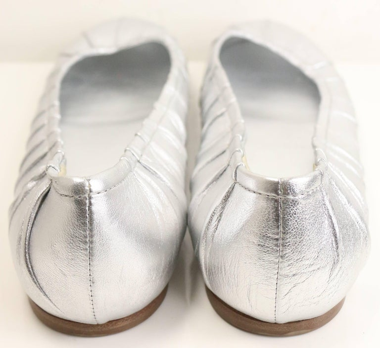 - Prada silver metallic leather flats with few pleated effect. Featuring a wooden sole. Chic and comfortable to wear.   - Made in Italy.   - Size 38.