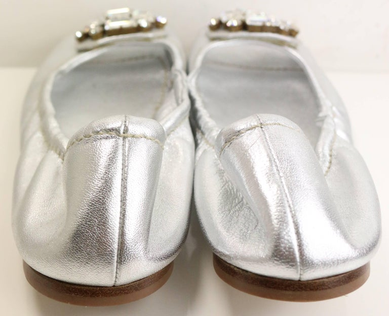 "- Mui Mui silver metallic open toe flats. Featuring A ""cross"" like rectangle rhinestones embedded in front surround with six round rhinestones. Its great for summer!   - Made in Italy.   - Size 38."