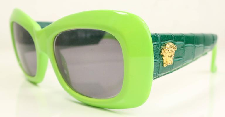 411785712cd Vintage 90s Gianni Versace green croc leather sunglasses with gold Medusa on  the side.