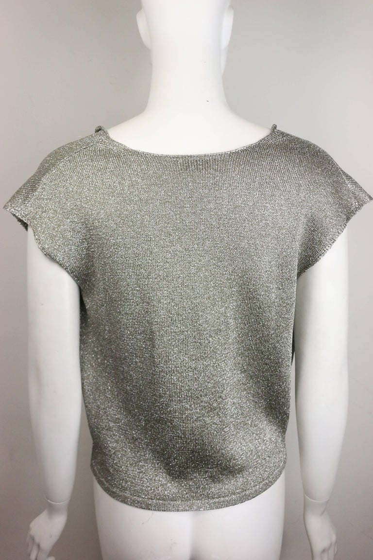 - Saint Laurent by Hedi Slimane silver metallic round neck top. This rock and roll and chic top is the signature of Hedi Slimane Saint Laurent era!   - Made in Italy.   - Size L.   - 60% Rayon, 40% Polyester.