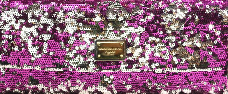 - Dolce and Gabbana pink/silver/black sequins shoulder bag. Featuring a silver, gold and black metal hardware chain strap, silver metallic leather trimming and inner flap with black satin interior and one small interior slip pocket. A magnetic