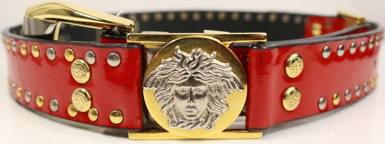 - Vintage 90s Gianni Versace red patent leather belt. Featuring  two