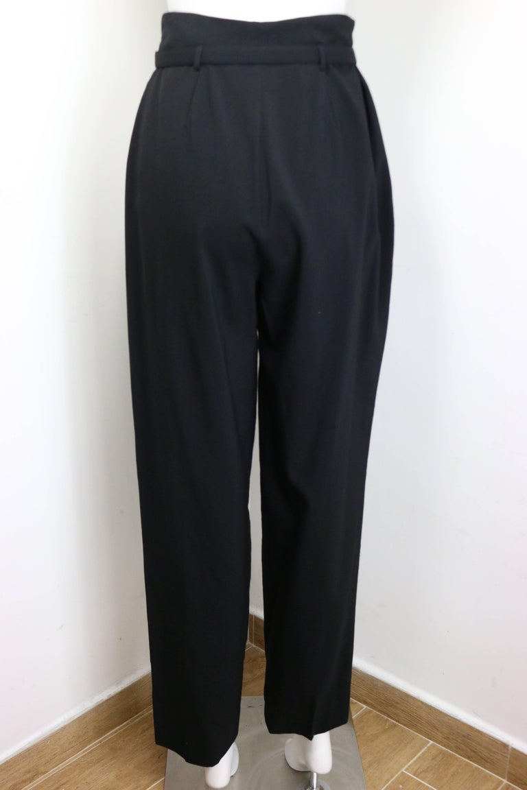 """- Vintage black wool carrot pants from year 1998 Pre collection. Featuring a zipper and snap button with a wool """"Chanel"""" belt closure.  - Made in France.   - Size 40.   - 100% Wool."""